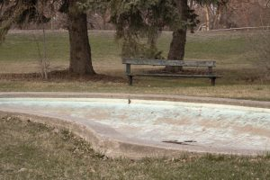 cement pond and broken bench