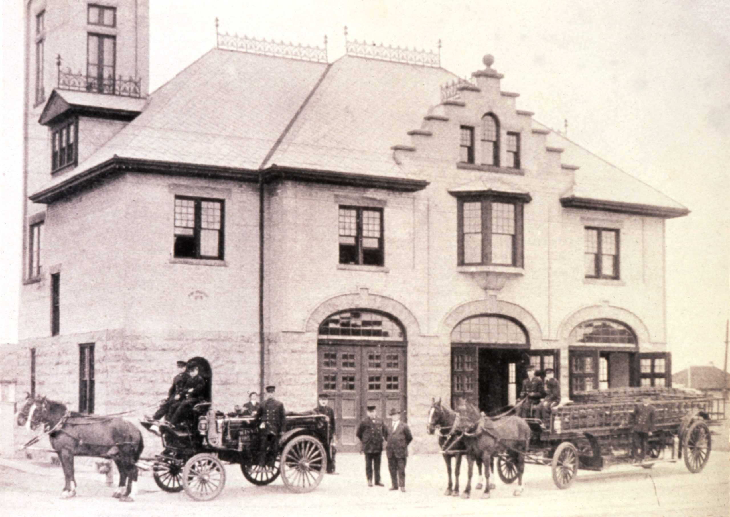 Horse-Drawn Fire Ladder Truck And Hose Truck In Front Of Fire Station #15 on Osborne St.